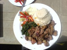 Nyama Choma (Grilled beef) and Ugali (maize meal porridge) with stewed greens Zambian Food, Corn Maize, Grilled Beef, Home Food, Yummy Food, Delicious Meals, Pot Roast, Ethnic Recipes, African Recipes