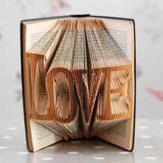 Wow! How amazing is this?   LOVE Folded Upcycled Book Art Sculpture. £25.00, via Etsy.