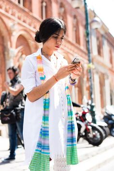 Street Style portraits by Ángel Robles. Fashion Photography from Milan Fashion Week. Woman on the street wearing a white shirt dress and Missoni scarf before Missoni show, Milano.