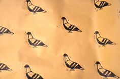 Pigeon wrapping paper :)    https://www.etsy.com/listing/117363617/pigeon-wrapping-paper-lino-printed-by