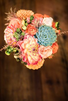 Brides.com: 15 Pretty Peach Bouquets. Bouquet of peach roses, dahlias, zinnias, and green succulents from Celsia Florist.