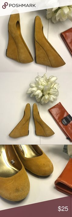 Mustard yellow faux-suede wedges Perfect for fall!! Cute with tights and skirt or jeans. Merona mustard yellow (tan / yellow) wedges. Some wear on faux suede (see pictures) but otherwise excellent used condition. Merona Shoes Wedges