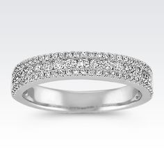 Three rows of sparking diamonds make up this dazzling wedding band crafted from quality 14 karat white gold. Eighty-one round diamonds, at approximately .58 carat total weight, were hand-selected and hand-matched for exquisite fire and brilliance.
