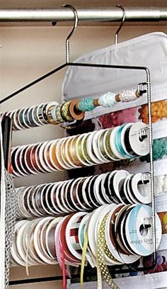 Storage idea for ribbon using pants hangers... GENIUS!