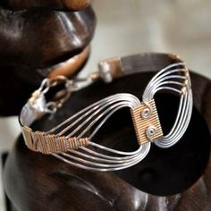 Egyptian Bracelet with a Twist. wire wrapped Sterling Silver and 14K Gold filled. by UntwistedSister for $70.00