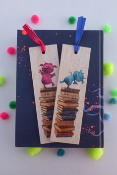 Keep track of your place in a favourite book, journal or magazine with this unique handmade wood cute pink or blue monster bookmark. You will no longer need to reach for an old receipt or scrap of paper to mark your place…and no more folding the corners of pages! Each bookmark is handmade in Australia using lightweight, flexible wood, gorgeous photo image transfer and finished with coloured ribbon. #stitchandwood #bookmarks #monsters #giftidea #read Monster Bookmark, Flexible Wood, Wood Transfer, Little Monsters, Ribbon Colors, Book Journal, Cute Pink, Book Lovers, Are You The One