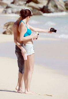 Selena Gomez on the beach with Justin Bieber in Los Cabos, Mexico on December 2011