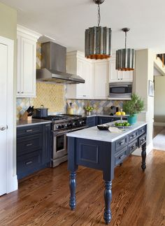 traditional kitchen idea with blue bottom cabinets white upper cabinets stainless steel appliances white top kitchen island with blue cabinets wood floors of Tens of Inspiring Kitchen Islands with Storage and Chairs