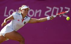 Angelique Kerber Photos - Angelique Kerber of Germany returns the ball to Venus Williams of the United States during the third round of Women's Singles Tennis on Day 5 of the London 2012 Olympic Games at Wimbledon on August 1, 2012 in London, England. - Olympics Day 5 - Tennis
