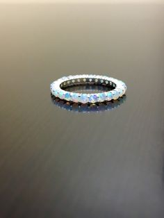 Eternity Opal Engagement Band - Opal Eternity Band - Opal Wedding Band - Eternity Opal Band - Sterling Silver Opal Band - Opal Silver Band by DeKaraDesigns on Etsy https://www.etsy.com/listing/203759786/eternity-opal-engagement-band-opal