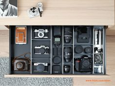 Storage idea for camera and accessories! Drawer with ORGA-LINE inner dividing system. More inspiration for an organized home on www.blum.com/ideas