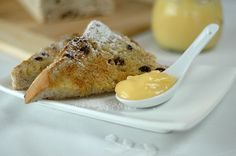 Sliced thickly and toasted, raisin bread served with chilled lemon curd is a perfect breakfast.