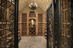 Brick barrel ceiling at Wine Cellar, behind iron gates...