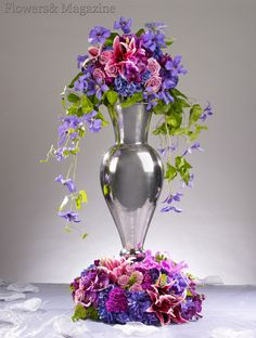 A tall urn with Vanda orchids, hydrangea, lilies, roses and a graceful cascade of flowering clematis vine for the church or reception.  design by Alex Jackson AIFD, photography by Ron Derhacopian.  #flowersandmagazine   #flowers  #Wedding flowers