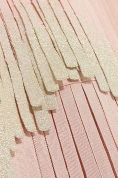 Blush and silver bandage Hook fastening at neck, concealed hook and zip fastening at back 90% rayon, 9% nylon, 1% spandex; trim: 57% rayon, 24% nylon, 19% metallic fibers  Dry clean
