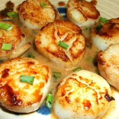 PAN-SEARED SEA SCALLOPS in Herb Butter Wine Sauce Recipe | Just A Pinch Recipes