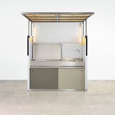 The Tilt Outdoor Kitchen designed by Justin Hutchinson combines Tait's love for backyard living and barbecuing in a good-looking package