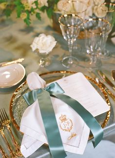Napkin- a natural linen tied with a satin ribbon