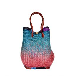 Mia Straw basket, tote, bag, with  2 different color shades.  Our lovely basket can be changed it shape in to oval shape. You can use it as a basket for farmers market or a beach bag or any outdoor activities.  Mia tote with a leather handles is made of straw by the  artisan women from Madagascar, Africa.  Dimensions: 18W x 14H x10D
