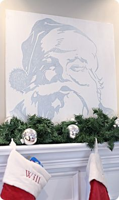 Katie from Bower Power was looking for a simple and classic centerpiece for her Christmas mantel when she stumbled upon a canvas of Old St. Nick himself in a catalog. She used the grid method she learned in middle school art to sketch the image from the tiny catalog pic onto a piece of painted plywood. Then she filled it all in with a silver paint pen for a  light, shimmery look....LOVE IT!!
