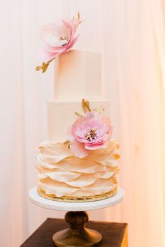 Unique wedding cake, pink paper flowers, gold leaves, textured icing // Brooke Beasley Photography