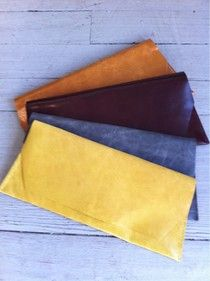 long leather clutches by stitch and tickle