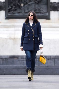 God is in the detail – so if you love a bit of drama and glamour find a double breasted military coat that is embellished with gold dome buttons, beautiful gold rings around the sleeve cuffs, like this one!