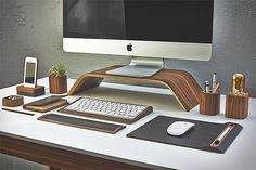 Grovemade Walnut Desk Collection Natural walnut woodgrain highlights this collection of clean, modern office accessories from Grovemade. From a stand for your display to mouse pad, phone charger, pen cup, to cases for iPad & iPhone, they've got the good wood.