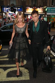 Kate Moss was ladylike as ever in a sheer fit-and-flare dress as she and husband Jamie Hince hit the town in London.