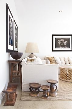 Love the African feel added in this living space with all these African stools!