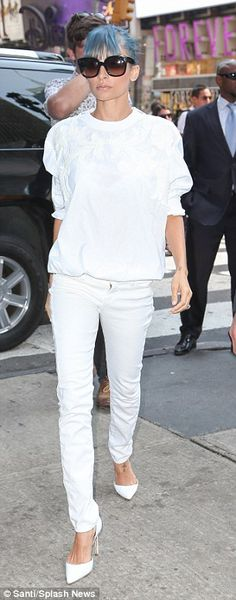 All-white: Earlier on Monday Nicole showed off a crisp white look as she arrived at the MTV studios