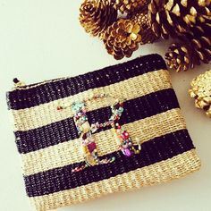 Striped abaca pouch with zipper and beads