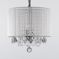 Your dining room will gain a sophisticated air with this crystal chandelier with shade. The draped crystals give it a graceful look that would look great with traditional decor, and the white shade allows it to coordinate with different color schemes.