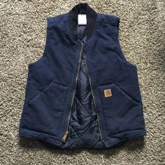 Men's Carhartt vest Men's Navy blue Carhartt vest with a black collar. There is a zipper up the middle, pockets on the side, and one pocket inside. Carhartt Jackets & Coats Vests