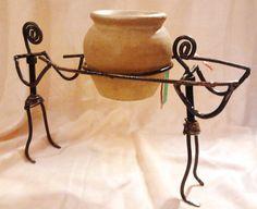 porta vaso omini in ferro battuto