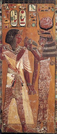 Hathor greeting the pharaoh Seti I with the magic collar that she had given (1279 BC. Nineteenth Dynasty). From the tomb of Seti I in the Valley of the Kings