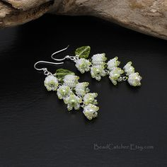 Spring Lily of the valley earrings are made with tiny bead woven Lily-of-the-valley flowers, pearls, glass leaves. Very delicate, spring flavored and absolutely gorgeous! Great addition to your spring mood and outfit. Tiny flowers are made with smallest available glass seed beads from Japan in pearly white color. Earwire is hypoallergenic silver plated surgical steel. See more matching spring collection items with flowers in my garden collection store section and tutorial section for how…