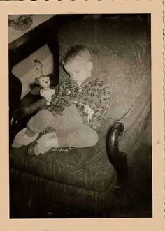 Vintage photograph little boy sleeping with Mighty Mouse doll
