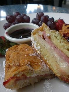 What is a Monte Cristo? It's a grilled ham, cheese and turkey sandwich dipped in batter and deep fried to crispy, golden deliciousness, sprinkled with powdered sugar and served with fruit jam. Drool!