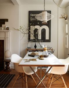 Simple, Eames Dowel Leg Base plastic armchairs. This dining area screams sophistication.