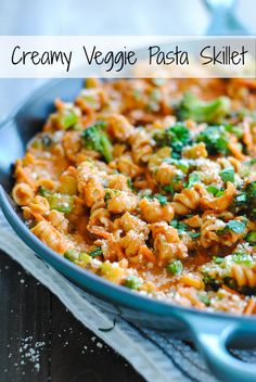Creamy Veggie Pasta Skillet - A hearty vegetarian meal that comes together in one skillet. Creamy pasta loaded with carrots, broccoli and pe...