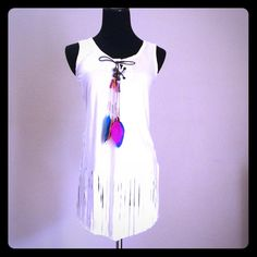 🆕Faux suede vest, fringed embellished feathers 🆕 Long, soft, trendy, chick, western, Faux  suede vest, fringed embellished with multicolor feathers. I do bundle to save you money.     Color: off white.      PLEASE NOTE: I have size S, M & L and I can make you a listening with YOUR size. Tops Tunics