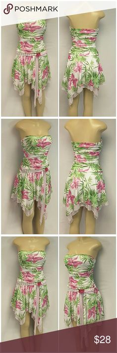 """40% BUNDLE DISCOUNT! FREE SHIPPING ON BUNDLES!! XOXO MADE IN USA, Strapless Dress, size Medium See Measurements, lots of rusching and ruffles, hanky hem, drop waist self-tie, 100% polyester, approximate measurements: 26"""" shortest length, 14"""" bust laying flat but stretches to 18"""" comfortably. ADD TO A BUNDLE! 40% BUNDLE DISCOUNT! FREE SHIPPING ON BUNDLES!! ?OFFER? $6 LESS ON BUNDLES! Only ?offers? of $6 less on Bundles for shipping reimbursement. XOXO Dresses Strapless"""