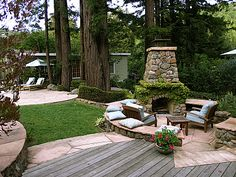 Outdoor fireplace patio love the circular space! Needs a roof for PNW.