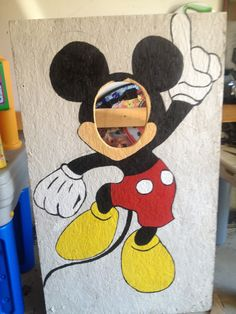 Mickey mouse face in the hole- homemade, my dad cut the hole and i drew/painted! Turned out really good!
