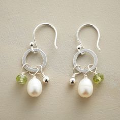 """PERIDOT AND PEARL EARRINGS--One peridot, cultured pearl and shiny bead per earring is more than enough to enliven simple hoops. They sway from French wires on our exclusive handcrafted design. sterling silver. 1-1/4""""L."""
