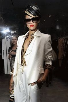 White suit with leopard print, red lips, and of course, ba shades.
