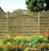 St. Meloir Decorative Fence Panel. A beautiful and popular decorative wooden garden fence panel featuring a diamond trellis arched top section. Available in 1.05m and 1.85m heights from £53.71. #DecorativeFencePanels #AWBS #GardenFencePanels