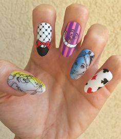 <p>Garcia's salon modifed Alice in Wonderland nails.</p>