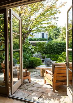 An east-facing terrace is a delightful spot to sit in the afternoon. New Home with Modern and Traditional Elements | Traditional Home